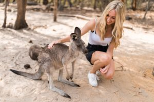 Lydia Collins patting a kangaroo